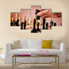 Male hand moving the black chess knight multi panel canvas wall art