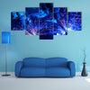 Welding robots movement in a car factory multi panel canvas wall art