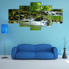A Mountain stream in a tropical rain forest multi panel canvas wall art