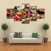 Appetizers on a wooden cutting board Multi panel canvas wall art