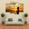 A Boy Praying With Deep Attention On A Beach In Front Of The God In The Evening Multi Panel Canvas Wall Art