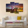 A man looking at the cityscape of Kuwait Multi Panel Canvas Wall Art