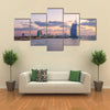 View of the illuminated Burj Al Arab and Jumeirah Beach Hotel at the sunset Multi panel canvas wall art
