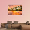 Beautiful tropical beach with palm trees at sunset Multi panel canvas wall art