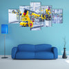 robotic arms in a car plant multi panel canvas wall art