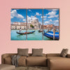 Beautiful view of traditional Gondolas on Canal Grande with historic wall art
