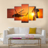 Military Mission at Sunset. Marines Helicopters Air Mission. Soldier with Assault Rifle Cover the Area Multi Panel Canvas Wall Art