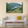 Passenger train passing through polish countryside Multi panel canvas wall art