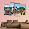 People visit old bridge and town gate in Heidelberg, Germany wall art