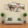 Sprinting Dynamic Greyhounds On The Race Course Multi Panel Canvas Wall Art