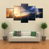 A Man Praying In Front Of The God In A Windy Storm And The Sunrise Multi Panel Canvas Wall Art