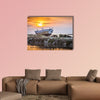 An old and weathered boat at the Sicilian sunset multi panel canvas wall art