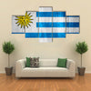 Flag of Uruguay or Uruguayan banner on wooden background Multi panel canvas wall art
