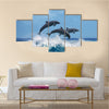 Three Beautiful Dolphins Jumping Over Breaking Waves Multi Panel Canvas Wall Art