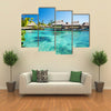 The Beauty Of The Water Bungalows With A Green Lagoon, Maldives, Multi Panel Canvas Wall Art