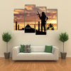 Armed terrorists near the mosque at sunset Multi Panel Canvas Wall Art