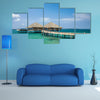 The Water Bungalows on the tropical lagoon in Maldives Multi Panel Canvas Wall Art