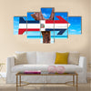 Dominican Republic flag sign with arrow on beach Multi Panel Canvas Wall Art