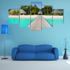 The Beach Bungalows On A Tropical Island Multi Panel Canvas Wall Art