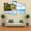 Beachfront bungalow on a tropical island Multi panel canvas wall art