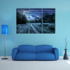 Curved Roads In A Rural Valley Crossing The Mountains With Snowy Peak In A Winter Landscape, Multi Panel Canvas Wall Art