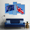 European Union flag and flag of UK on flagpole Multi panel canvas wall art