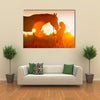 Beautiful silhouette of girl and horse at sunset multi panel canvas wall art