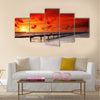 Gorgeous sunset over the sea and a jetty in the tropical paradise of Caribbean Multi Panel Canvas Wall Art
