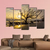 A flock of gulls flies over a driftwood covered beach at sunrise wall art
