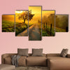 Rural landscape on a hill with a tree on a meadow at sunrise, canvas wall art