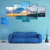 Beautiful sunrise with water villas in tropical Maldives island Multi Panel Canvas Wall Art