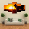 Silhouette Of A Akita Inu Dog At Golden Sunset. Multi Panel Canvas Wall Art