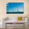 Windmills in a row further, horizontal Multi Panel Canvas Wall Art