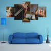 Barber Holding and Cutting hair of a Client, Hair Care Concept Multi Panel Canvas Wall Art