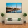 The Promenade Of Daugava In Riga, With Two Old Churches And Medieval Cost, Latvia Multi Panel Canvas Wall Art