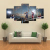 volleyball players in action on the open air court Multi panel canvas wall art