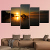 Lake Chicot is bathed in golden sunrise multi panel canvas wall art