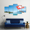 Female Hand Holding Switzerland Flag On Geneva Lake Multi Panel Canvas Wall Art