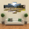 A Group Of Hikers Climbing On The Tein Shan Mountains In Kyrgyzstan Multi Panel Canvas Wall Art