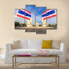 Democracy monument with blue sky and thai flag foreground in sunshine day, Bangkok, Thailand Multi panel canvas wall art