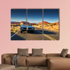 Man driving vintage car through desert multi panel canvas wall art