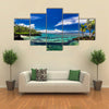 Natural infinity rock pool with palm trees over tropical ocean lagoon multi panel canvas wall art