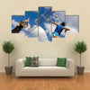 A volleyball player jumps to spike while another prepares to competition Multi panel canvas wall art