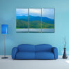 View of mountain forest landscape with heavy blue sky multi panel canvas wall art