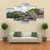 Many Colorful Homes on Grenada Hillside Multi panel canvas wall art
