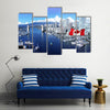 Canadian flag in front of view of False Creek Canada Multi panel canvas wall art