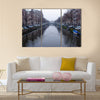 Along the canal walk citizens and moving vehicles Multi panel canvas wall art