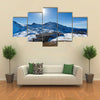 People are resting in the ski resort of Andorra in the mountains Multi panel canvas wall art