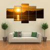 The Reflection Of The Sunlight Over A Lake Along With Clouds Multi Panel Canvas Wall Art
