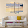 Sunset in the swedish archipelago, pale orange and violet colors wall art
